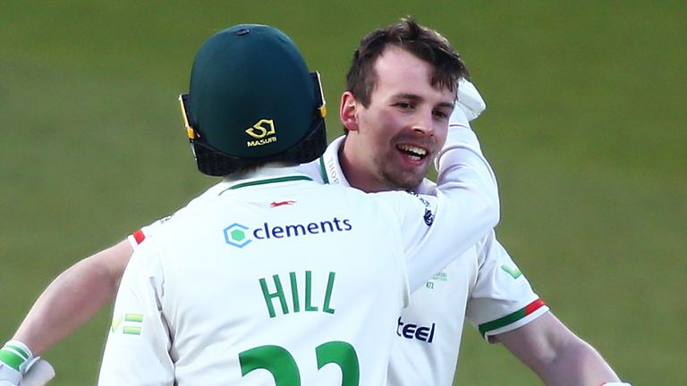 Leicestershire's Sam Evans celebrates his century with Lewis Hill