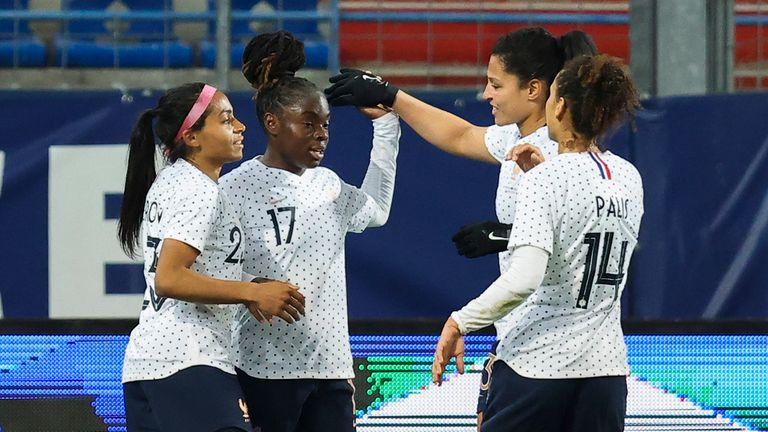 France's Sandy Baltimore (second left) celebrates with team-mates after scoring against England
