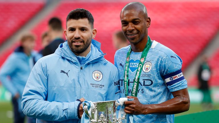 Sergio Aguero and Fernandinho celebrate with the trophy after winning the Carabao Cup (AP)