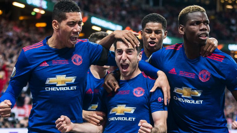 Chris Smalling congratulates Henrikh Mkhitaryan after he scores Manchester United's second goal in the 2017 Europa League final victory over Ajax