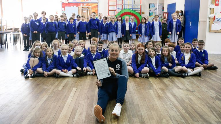 Sophie Ecclestone with the letter she read out at her old primary school at Helsby Hillside Primary School in Helsby (Credit: Tom Shaw for the ECB)