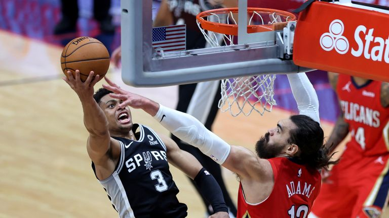 San Antonio Spurs forward Keldon Johnson (3) shoots as New Orleans Pelicans center Steven Adams (12) defends during the second half of an NBA basketball game in New Orleans, Saturday, April 24, 2021. (AP Photo/Rusty Costanza)