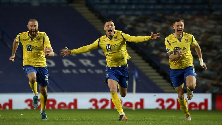 St Johnstone players celebrate their penalty shoot-out win at Ibrox