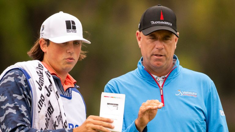 Cink has his son, Reagan, on his bag