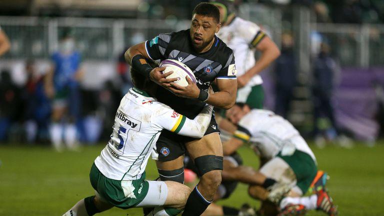 Taulupe Faletau is tackled by London Irish's Tom Parton