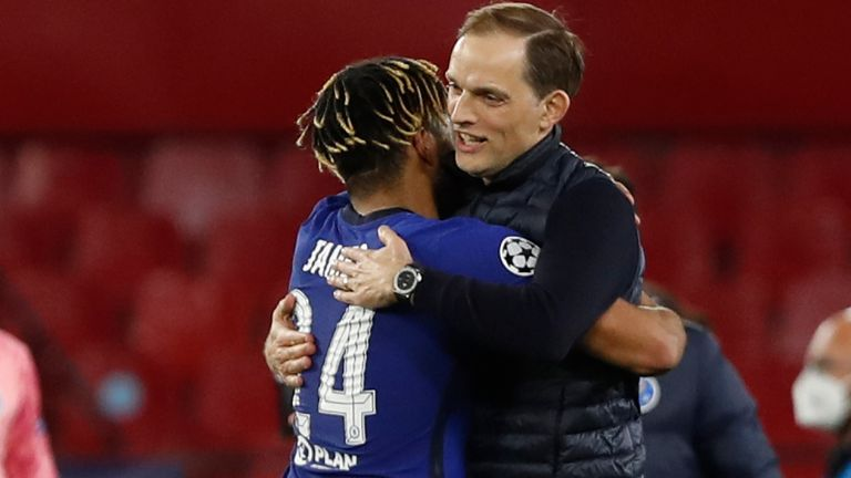 Chelsea's head coach Thomas Tuchel, right, celebrates with Chelsea's Reece James at the end of the Champions League quarter final second leg soccer match between Chelsea and Porto at the Ramon Sanchez Pizjuan stadium, in Seville, Spain, Tuesday, April 13, 2021. (AP Photo/Angel Fernandez)