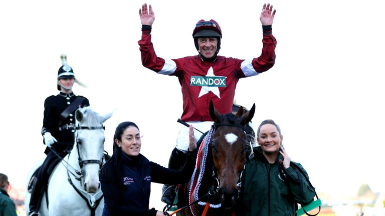 Jockey Davy Russell celebrates on Tiger Roll after winning Grand National in 2019