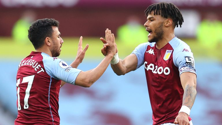 Trezeguet of Aston Villa celebrates with team-mate Tyrone Mings after scoring against Fulham