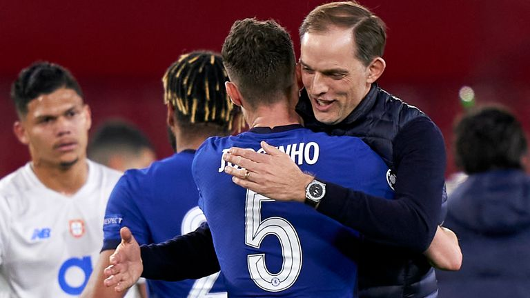 SEVILLE, SPAIN - APRIL 13: Thomas Tuchel, Manager of Chelsea FC and Jorginho of Chelsea FC celebrate following the UEFA Champions League Quarter Final Second Leg match between Chelsea FC and FC Porto at Estadio Ramon Sanchez Pizjuan on April 13, 2021 in Seville, Spain. Sporting stadiums around Spain remain under strict restrictions due to the Coronavirus Pandemic as Government social distancing laws prohibit fans inside venues resulting in games being played behind closed doors. (Photo by Jose M