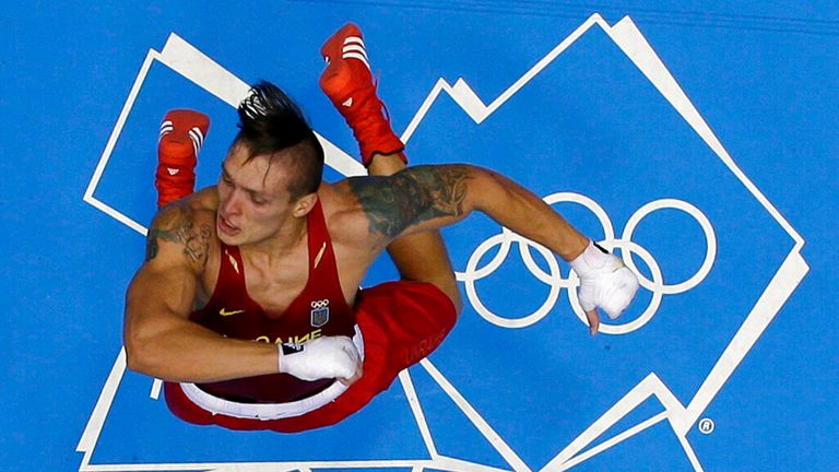 Ukraine's Oleksandr Usyk celebrates after defeating Italy's Clemente Russo to win the gold medal for the men's heavyweight 91kg boxing competition at the 2012 Summer Olympics, Saturday, Aug. 11, 2012, in London. (AP Photo/Mark Duncan)