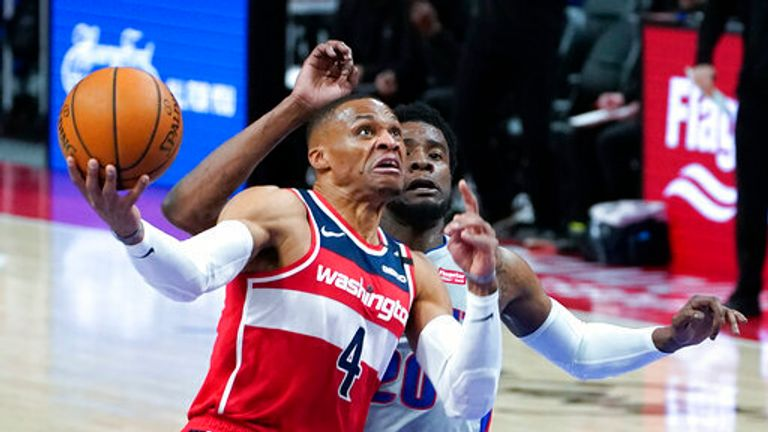 AP - Washington Wizards guard Russell Westbrook (4) drives past Detroit Pistons guard Josh Jackson (20)