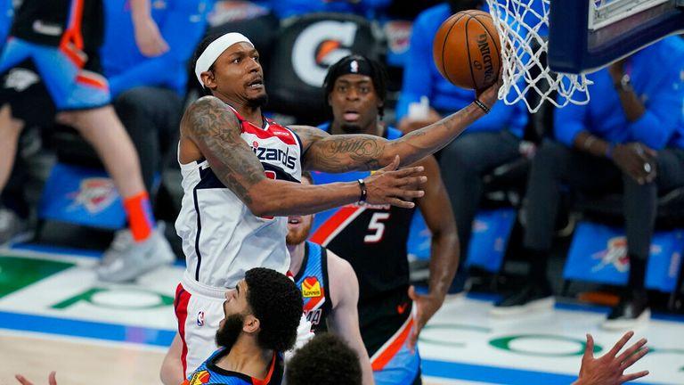 AP - Washington Wizards guard Bradley Beal shoots between Oklahoma City Thunder forward Luguentz Dort (5), forward Kenrich Williams, left, and center Isaiah Roby,