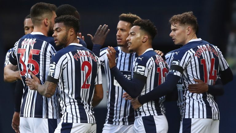 West Bromwich Albion's Matheus Pereira, 2nd right, celebrates with team mates after scoring his side's opening goal during an English Premier League soccer match between West Bromwich Albion and Southampton at The Hawthorns in West Bromwich, England, Monday April 12, 2021. (Tim Goode/Pool via AP)