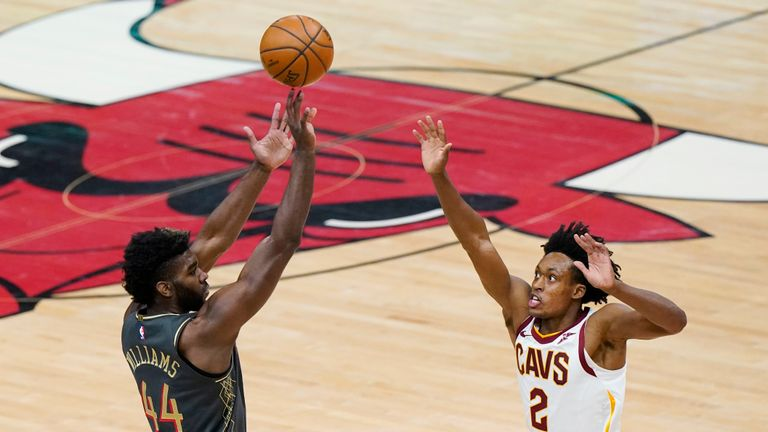 Chicago Bulls forward Patrick Williams, left, shoots over Cleveland Cavaliers guard Collin Sexton during the first half of an NBA basketball game in Chicago, Saturday, April 17, 2021. (AP Photo/Nam Y. Huh)