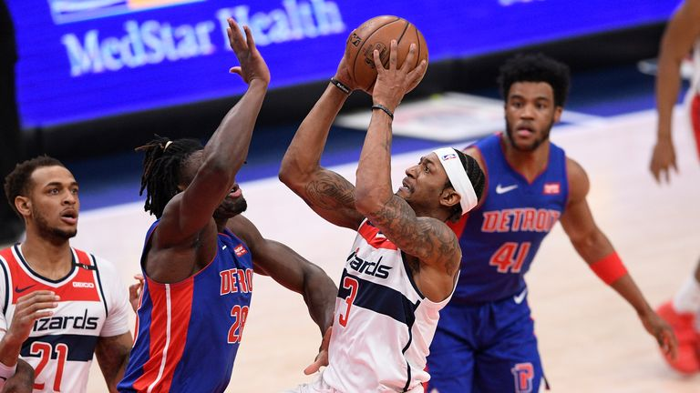Washington Wizards guard Bradley Beal (3) goes to the basket against Detroit Pistons center Isaiah Stewart (28) during the first half of an NBA basketball game, Saturday, April 17, 2021, in Washington. (AP Photo/Nick Wass)