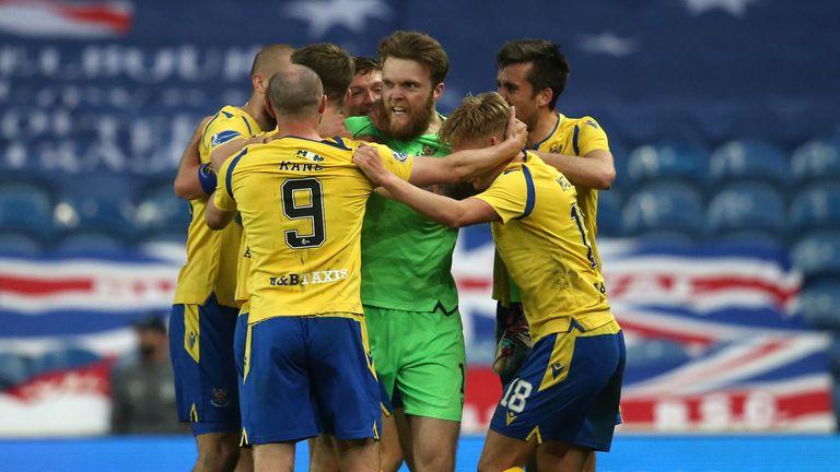 St Johnstone goalkeeper Zander Clark celebrates after his header comes off team-mate Christopher Kane