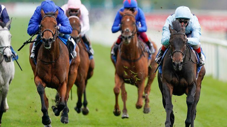 Andrea Atzeni riding Primo Bacio (R, light blue) to victory at York