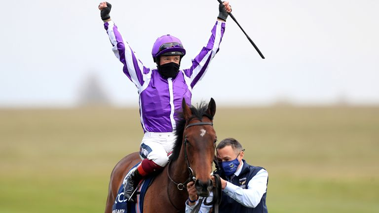 Frankie Dettori celebrates on Mother Earth after winning the Qipco 1000 Guineas Stakes