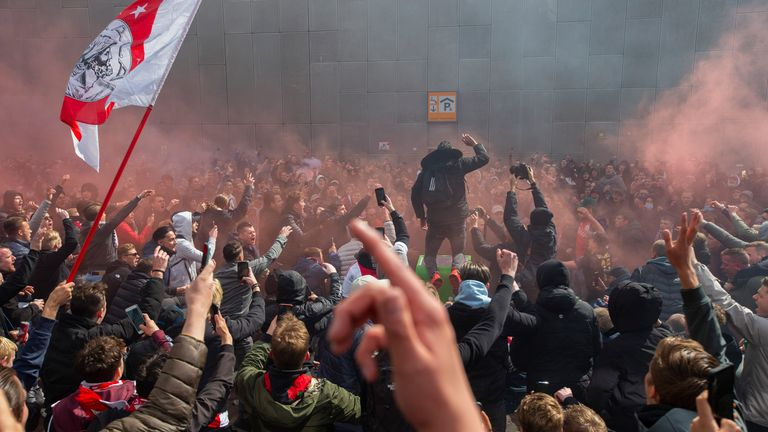 Ajax supporters celebrate as their team secured the Eredivisie title