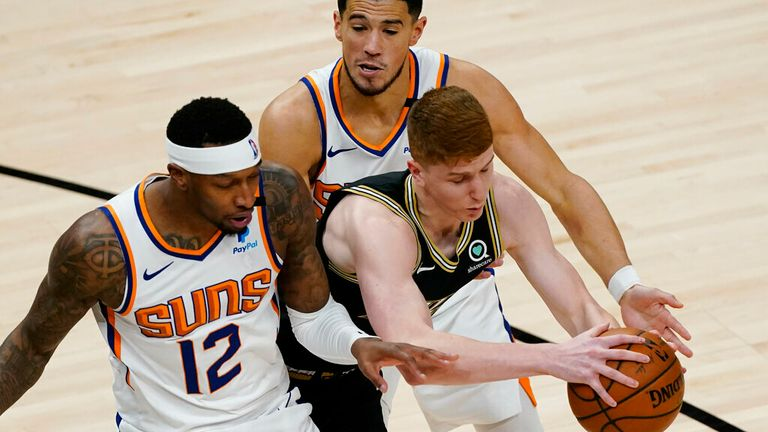 Atlanta Hawks guard Kevin Huerter (3) tries to go between Phoenix Suns Torrey Craig (12) and Devin Booker (1) in the first half of an NBA basketball game Wednesday, May 5, 2021, in Atlanta. (AP Photo/John Bazemore)