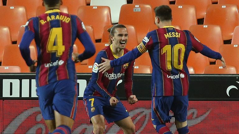 Barcelona moved to within two points of Atletico by beating Valencia