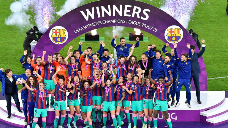 Barcelona players hold the trophy aloft after the UEFA Women's Champions League final against Chelsea
