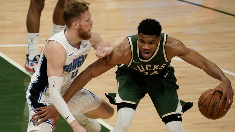 Giannis Antetokounmpo contributed 27 points and 12 rebounds as Milwaukee overcame Orlando in Tuesday's NBA action.