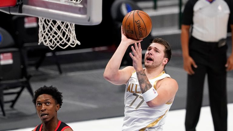 Luka Doncic contributed 20 points, 11 assists and 10 rebounds as Dallas beat Toronto.