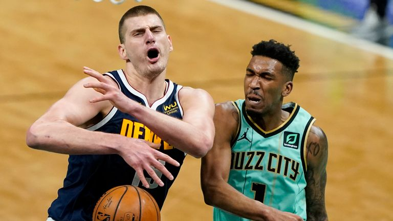 Nikola Jokic provided two phenomenal assists in Denver's victory over Charlotte.