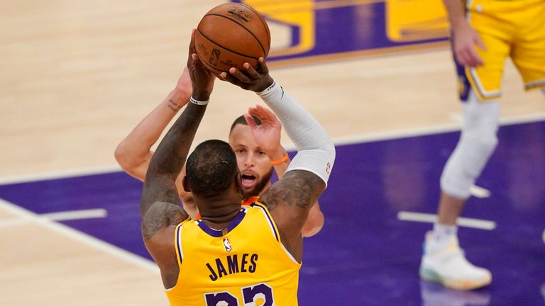 LeBron James had 22 points, 10 assists and 11 rebounds as the Los Angeles Lakers secured their place in the NBA Playoffs.