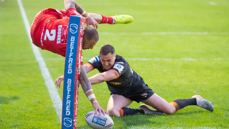 Castleford's James Clare can't prevent Hull KR's Ben Crooks from scoring a try