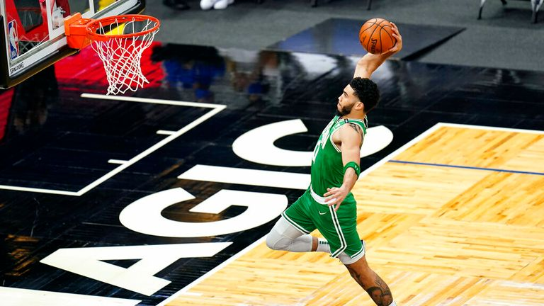 Boston Celtics forward Jayson Tatum goes up for an uncontested dunk during the first half of an NBA basketball game against the Orlando Magic, Wednesday, May 5, 2021, in Orlando, Fla. (AP Photo/John Raoux)