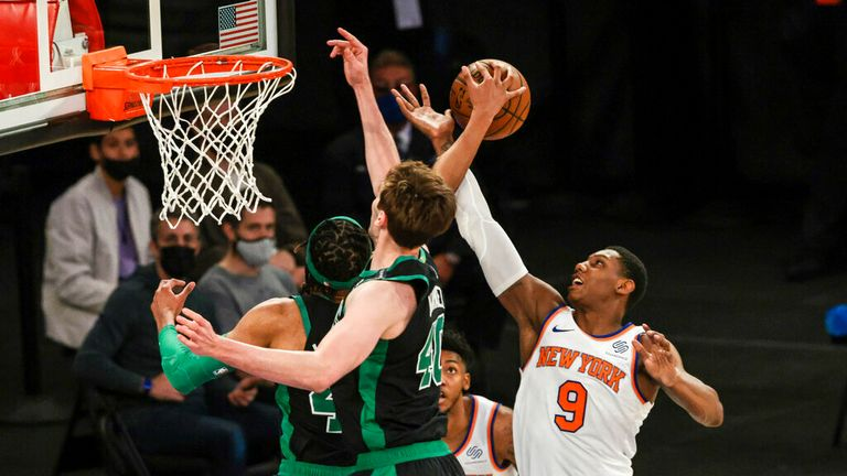 Boston Celtics center Luke Kornet (40) battles for the ball against New York Knicks guard RJ Barrett (9) during the second half of an NBA basketball game in New York, Sunday, May 16, 2021. (Vincent Carchietta/Pool Photo via AP)