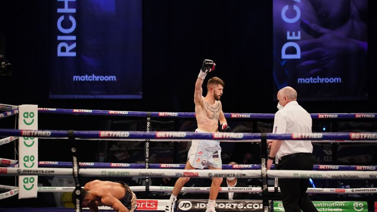 15 May 2021 Picture By Dave Thompson Matchroom Boxing Jason Cunningham raises his arm after flooring Yafai.