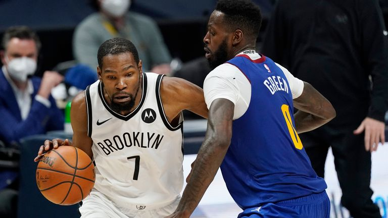 Brooklyn Nets forward Kevin Durant, left, drives to the rim as Denver Nuggets forward JaMychal Green defends in the second half of an NBA basketball game Saturday, May 8, 2021, in Denver. The Nets won 125-119. (AP Photo/David Zalubowski)................