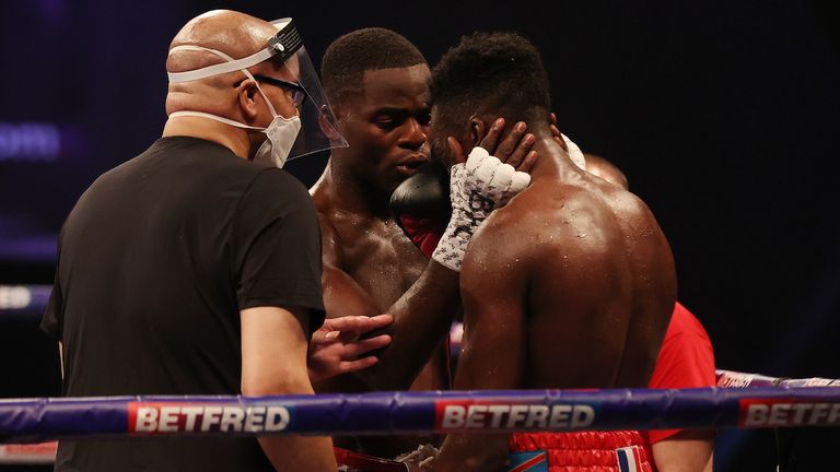 *** FREE FOR EDITORIAL USE ***.Joshua Buatsi and Daniel Blenda Dos Santos, WBA International Light-Heavyweight Title, AO Arena, Machester..15 May 2021.Picture By Mark Robinson Matchroom Boxing..Joshua Buatsi consoles his opponent after knocking him out.