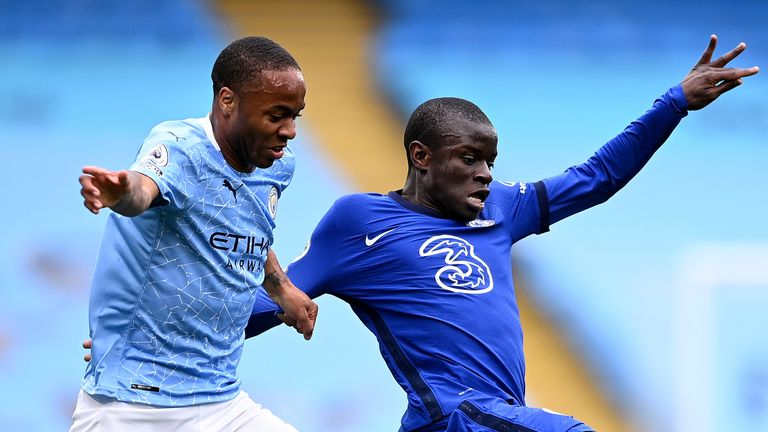 Manchester City's Raheem Sterling and Chelsea's N'Golo Kante challenge for the ball