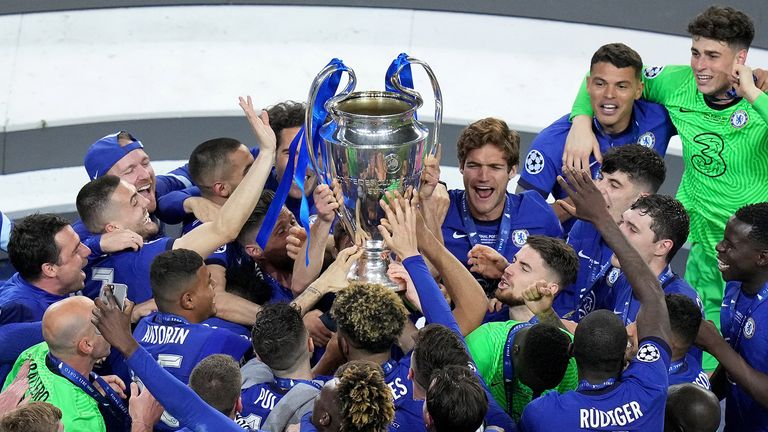 Chelsea players celebrate with the trophy after the UEFA Champions League final match held at Estadio do Dragao in Porto, Portugal