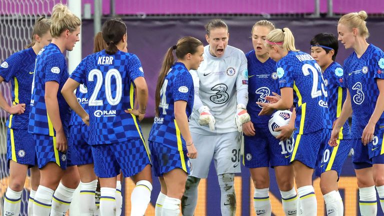 Ann-Katrin Berger tries to encourage her side after conceding a fourth goal