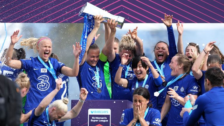 Chelsea players celebrate with the FA Women's Super League trophy after clinching the title at Kingsmeadow, London. Picture date: Sunday May 9, 2021.