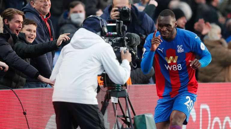 Crystal Palace's Christian Benteke celebrates his equaliser in front of fans (AP)