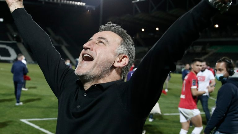 Lille head coach Christophe Galtier celebrates winning the French League.
