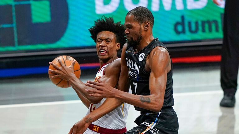 Cleveland Cavaliers' Collin Sexton (2) makes contact with Brooklyn Nets' Kevin Durant (7) during the second half of an NBA basketball game Sunday, May 16, 2021, in New York. Sexton was called for a flagrant foul and ejected from the game. (AP Photo/Frank Franklin II