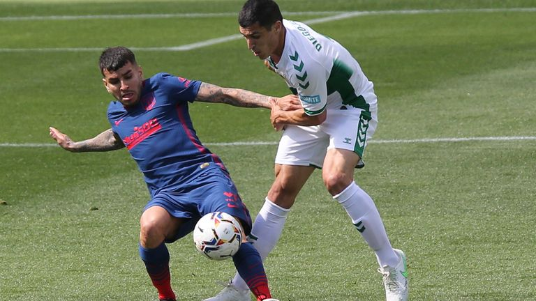 Atletico Madrid's Angel Correa vies for the ball against Elche's Diego Gonzalez