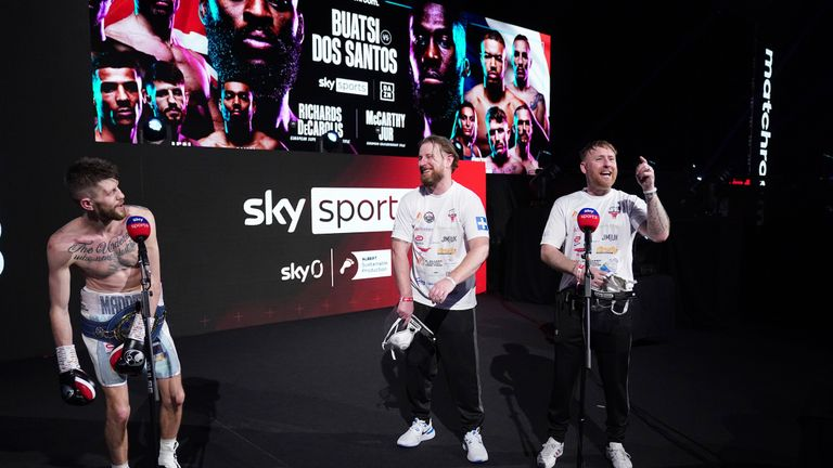 15 May 2021 Picture By Dave Thompson Matchroom Boxing. Jason Cunningham celebrates with his team after his win.