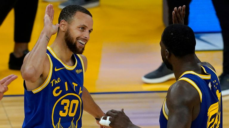 Golden State Warriors guard Stephen Curry (30) celebrates with forward Draymond Green during the second half of an NBA basketball game against the Utah Jazz in San Francisco, Monday, May 10, 2021.