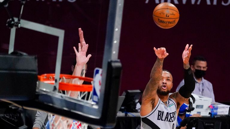 Portland Trail Blazers guard Damian Lillard (0) shoots a three-point goal during the second half of an NBA basketball game against the Brooklyn Nets, Friday, April 30, 2021, in New York. (AP Photo/Mary Altaffer)