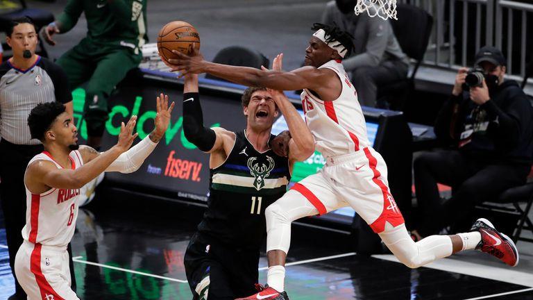 Milwaukee Bucks' Brook Lopez is fouled by Houston Rockets' Danuel House Jr.