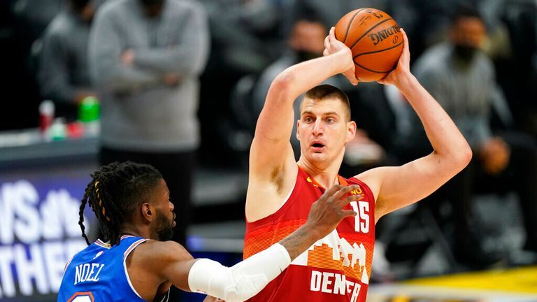 Denver Nuggets center Nikola Jokic (15) looks to pass the ball as New York Knicks center Nerlens Noel (3) defends in the first half of an NBA basketball game Wednesday, May 5, 2021, in Denver. (AP Photo/David Zalubowski)