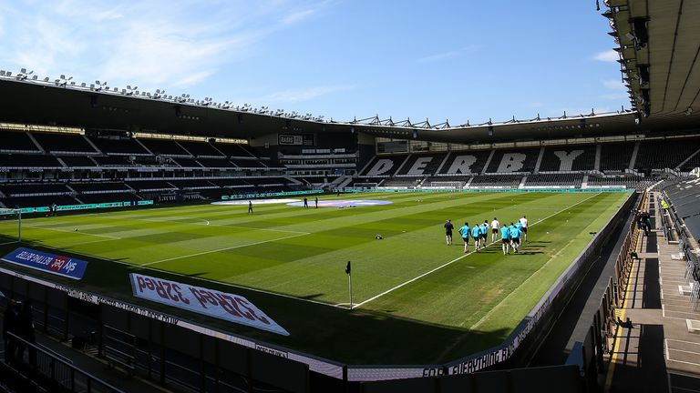 Derby County players warm up on the pitch ahead of the Sky Bet Championship match at Pride Park Stadium, Derby. Picture date: Saturday April 24, 2021.
